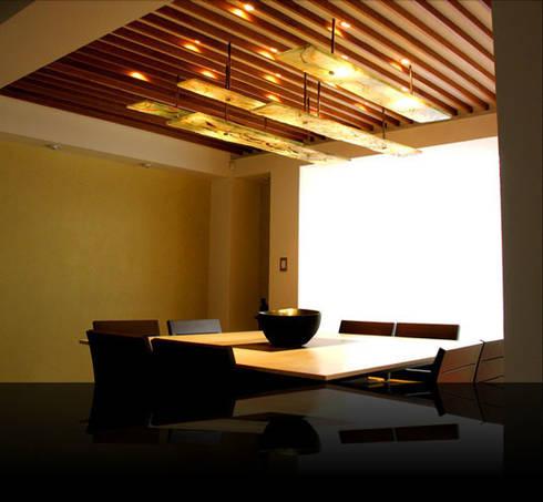 Iluminación: Comedores de estilo moderno por Xaquixe