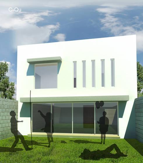 Vista posterior de casa C-QU: Casas de estilo moderno por ODRACIR