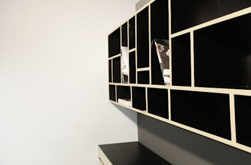 Mobiliario sobre diseño en privado gerencial: Oficinas y tiendas de estilo  por Quinto Distrito Arquitectura