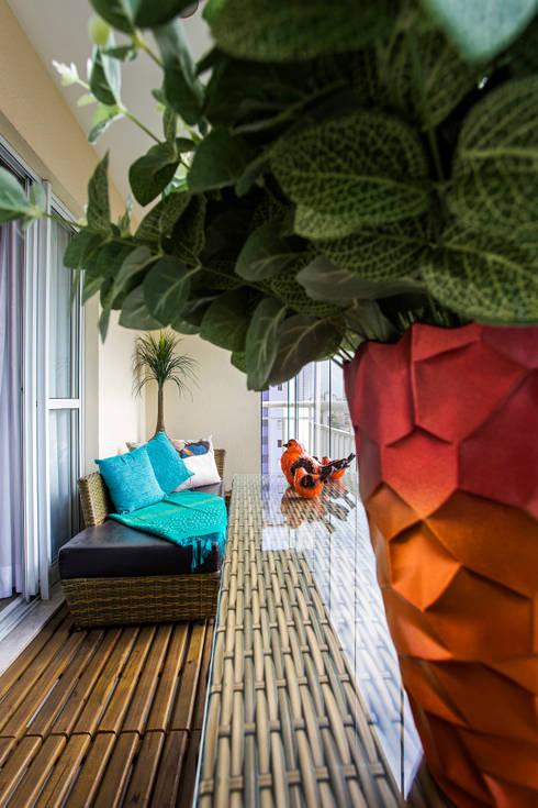 Detalhes varanda: Terraços  por Lo. interiores