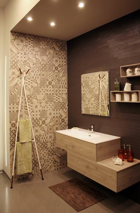 zona lavabo: Pareti in stile  di A.SAnnino & L.Sagliocco ARCHITETTI ASSOCIATI