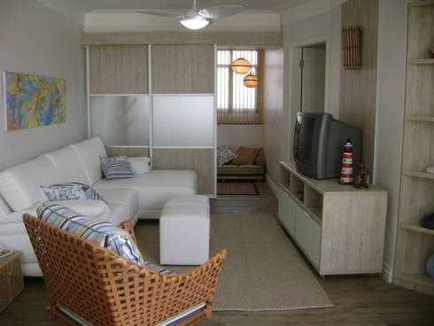 sala de tv e cantinho para relax:   por Flávia Brandão - arquitetura, interiores e obras