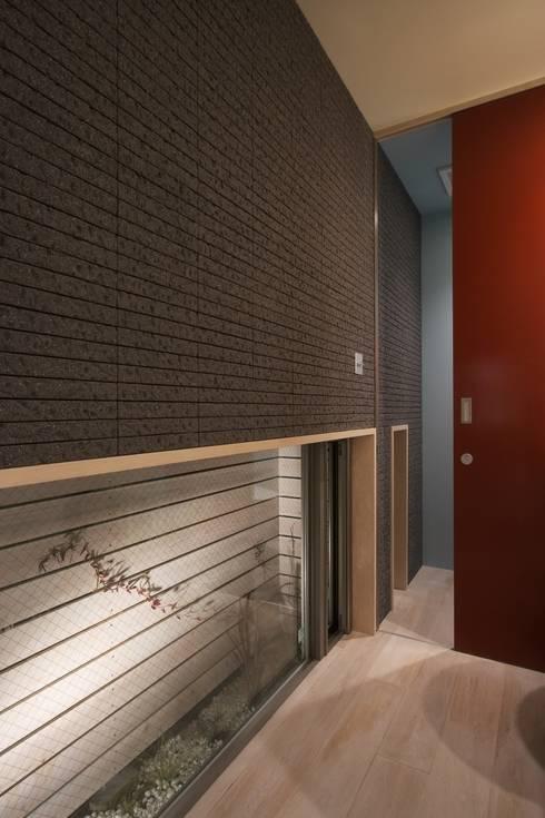 井の頭の家: TAMAI ATELIERが手掛けた浴室です。