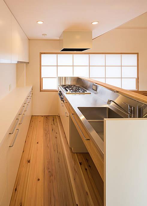 特注ステンレスキッチン: 河合建築デザイン事務所が手掛けたキッチンです。