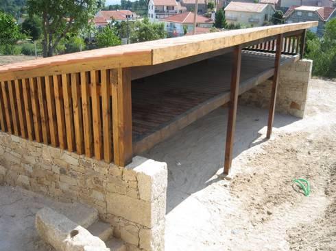 Casa do Mundo Rural de Prados 2: Casas rústicas por ARKIVO