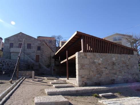 Casa do Mundo Rural de Prados 1: Casas rústicas por ARKIVO