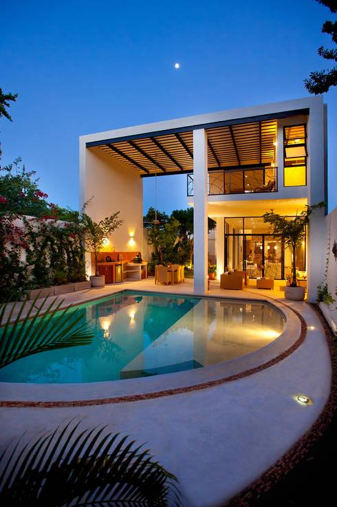 Casa CP78: Casas de estilo  por Taller Estilo Arquitectura