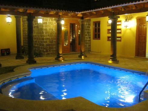 Casa de descanso fl: Albercas de estilo colonial por ipalma arquitectos