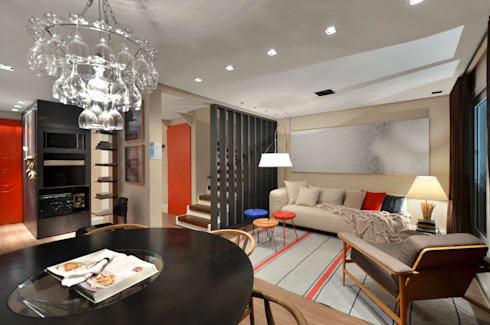Casa da Praia: Salas de estar tropicais por Johnny Thomsen Design de Interiores