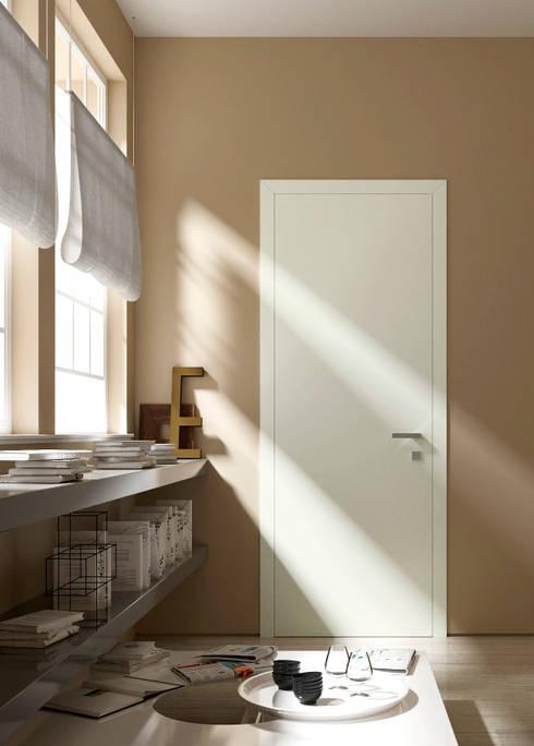 Thesi legno: Finestre & Porte in stile  di MOVI ITALIA SRL