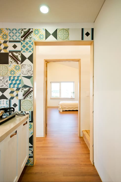 덕산 W-Building: JYA-RCHITECTS의  침실