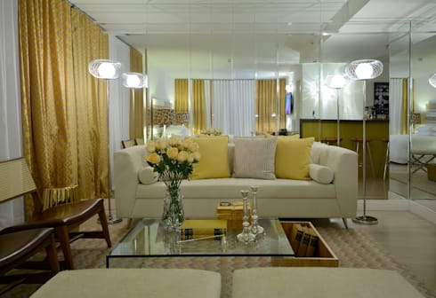 Suíte Neoluxo: Salas de estar ecléticas por Johnny Thomsen Design de Interiores