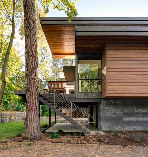 Casas de estilo  por Uptic Studios