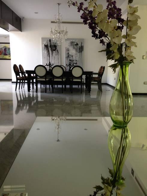 casa 25: Comedores de estilo moderno por Hussein Garzon arquitectura