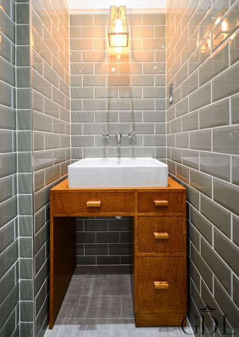 Full renovation on Trinity Road, London: modern Bathroom by Grand Design London Ltd