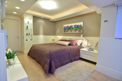 suite do casal moderno e elegante: Quartos  por Tania Bertolucci  de Souza     Arquitetos Associados