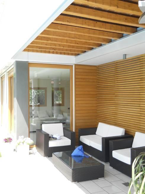 Ampliamento Villa e nuova Piscina: Case in stile  di Studio di Architettura Fiorentini Associati