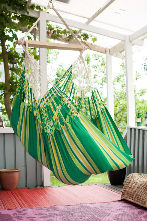 Cayo Lime Hanging Chair:  Balconies, verandas & terraces  by Emilyhannah Ltd