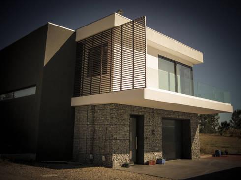 Habitação - Trancoso 5: Casas modernas por ARKIVO