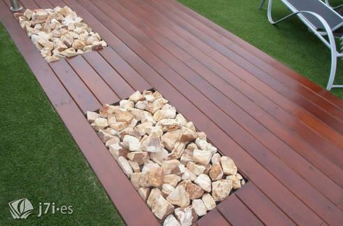 5. Un detalle de parterres inorgánicos: Jardines de estilo minimalista de Jardineria 7 islas