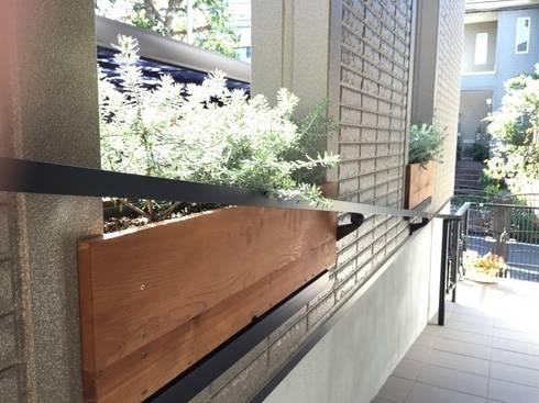 リズミカルな庭: 株式会社ムサ・ジャパン ヴェルデが手掛けた庭です。