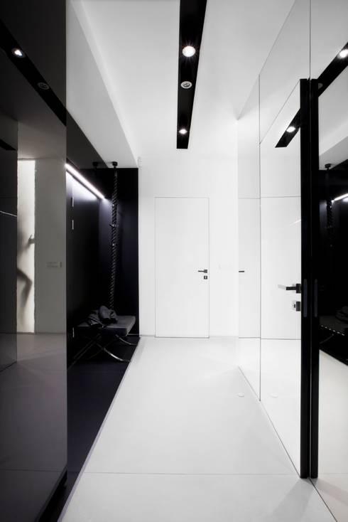 ART. – SPORT – RELAX  Warszawa - mieszkanie 90 m2 : styl , w kategorii Korytarz, przedpokój zaprojektowany przez TG STUDIO