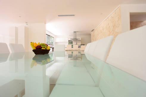 Casa T: Comedores de estilo moderno por Enrique Cabrera Arquitecto
