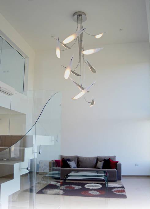 Luminaria Cardumen: Oficinas y locales comerciales de estilo  por Postigo design