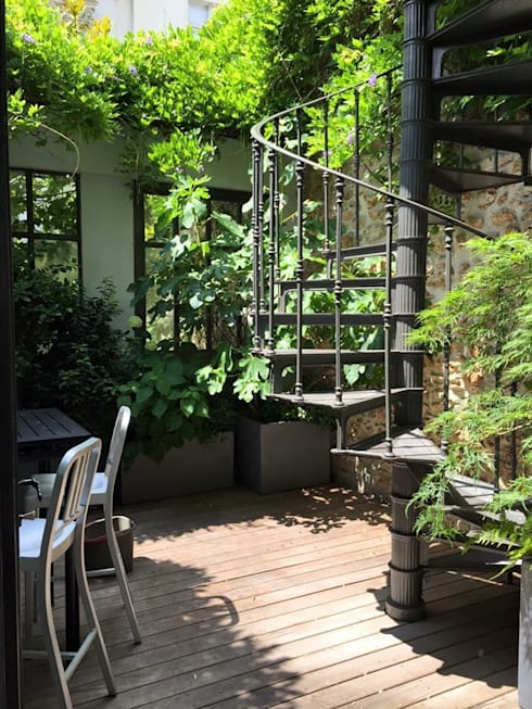 Jardín de estilo  por Agence sébastien Markoc