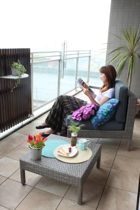 ファーストリビング「オープンカフェプラン」: 東邦レオ株式会社が手掛けたバルコニー&ベランダ&テラスです。