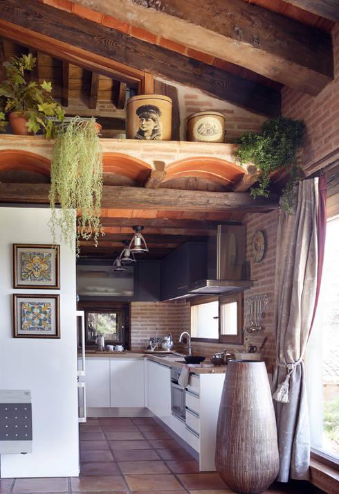Cozinha  por CONSOLIDACIONES Y CONTRATAS S.L