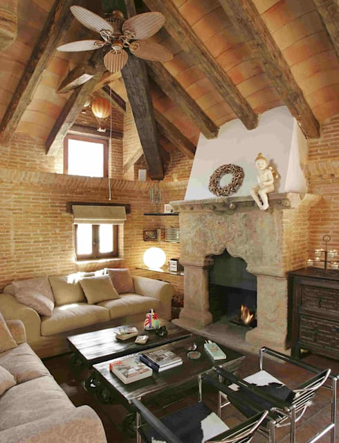 rustic Living room by CONSOLIDACIONES Y CONTRATAS S.L