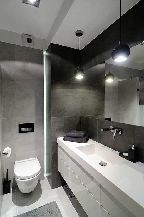 Beton udomowiony – czyli nowoczesne mieszkanie w Krakowie.: styl , w kategorii Łazienka zaprojektowany przez ARTEMA  PRACOWANIA ARCHITEKTURY  WNĘTRZ