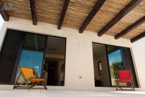 CASA MANGULICA: Casas de estilo moderno por Alberto Zavala Arquitectos