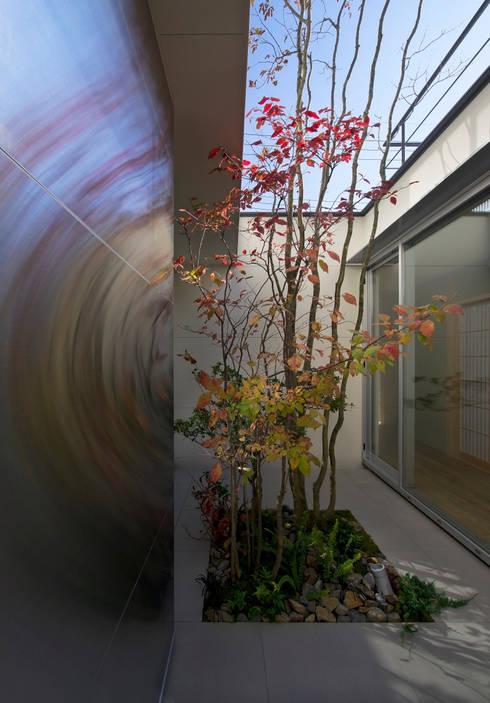 茨木の家: GREENSPACEが手掛けた庭です。