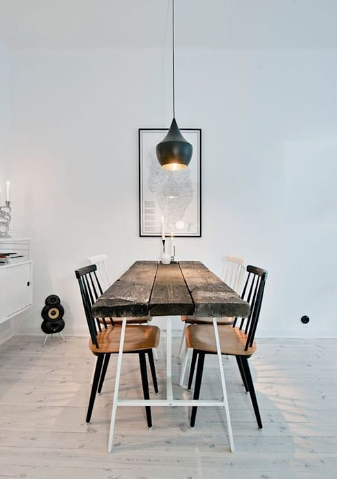Modern, rustic eating: rustic Dining room by 99chairs