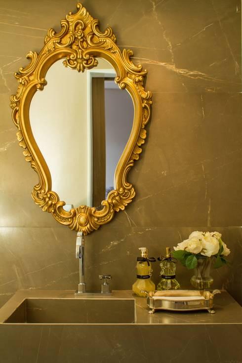 Detalhe do lavabo: Banheiros modernos por Jamile Lima Arquitetura