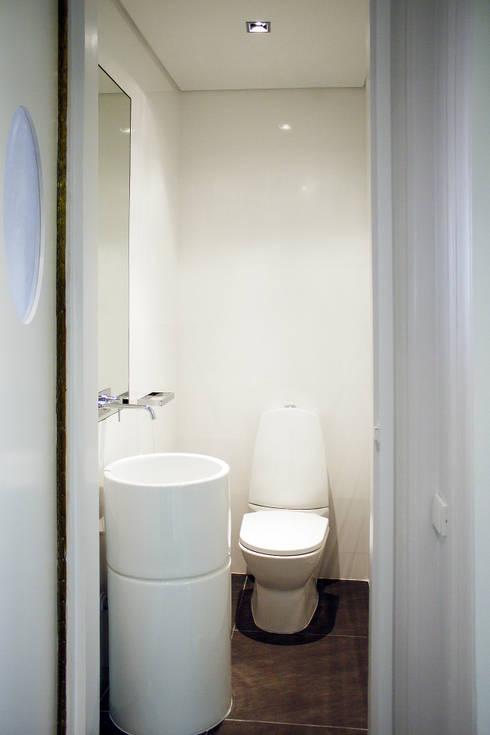 Apartamento em Lisboa : Casas de banho minimalistas por Archimais