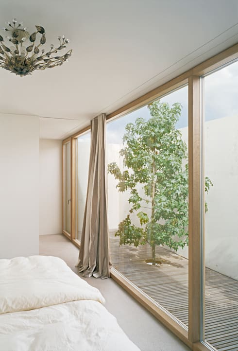modern Bedroom by Rossetti+Wyss Architekten