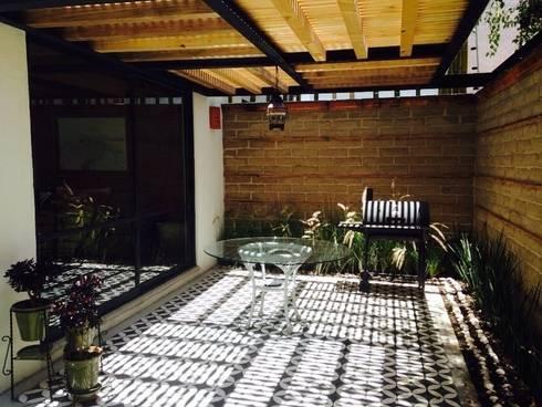 Rincón La Huerta: Casas de estilo ecléctico por Interark