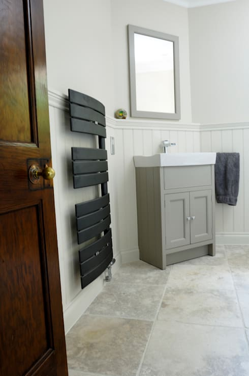 Black bathroom towel radiator: modern Bathroom by Mr Central Heating
