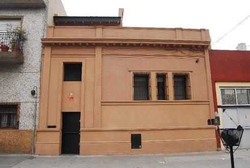 FACHADA después : Casas de estilo ecléctico por Parrado Arquitectura