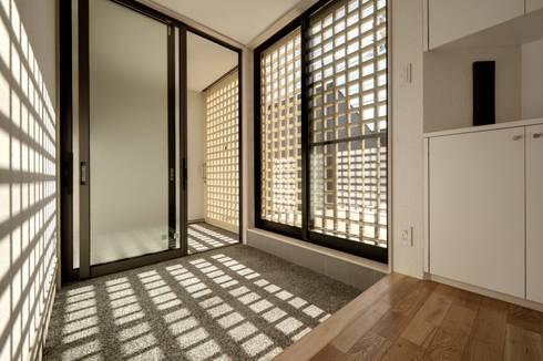 清洲の家: 株式会社FAR EAST [ファーイースト]が手掛けた廊下 & 玄関です。