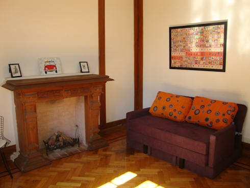 Departamento sobre la calle Rivadavia esquina Pichincha: Livings de estilo moderno por Hargain Oneto Arquitectas
