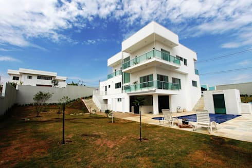 Residência em Brasília - DF: Casas modernas por Domingos Bidoia Arquitetura