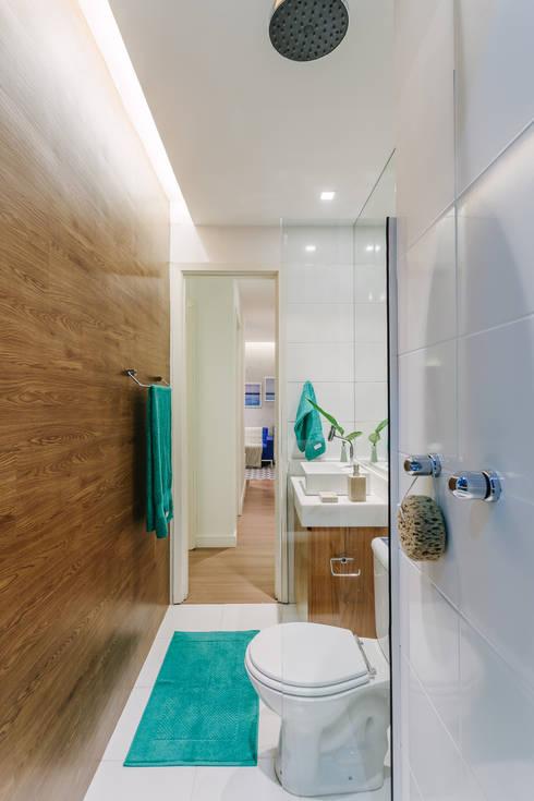 Apartamento Bela Vista: Banheiros modernos por STUDIO LN