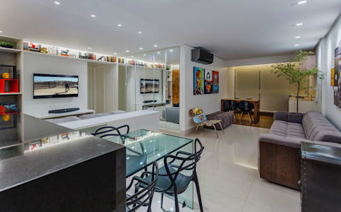 TROPICAL LOFT: Salas de jantar industriais por STUDIO ANDRE LENZA