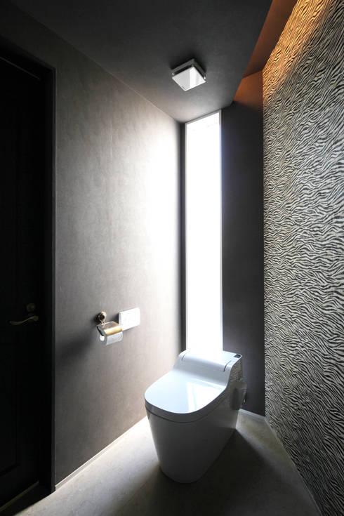 トイレ: atelier mが手掛けた浴室です。