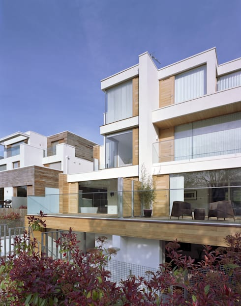 Natropolis Apartments: modern Houses by Coupdeville