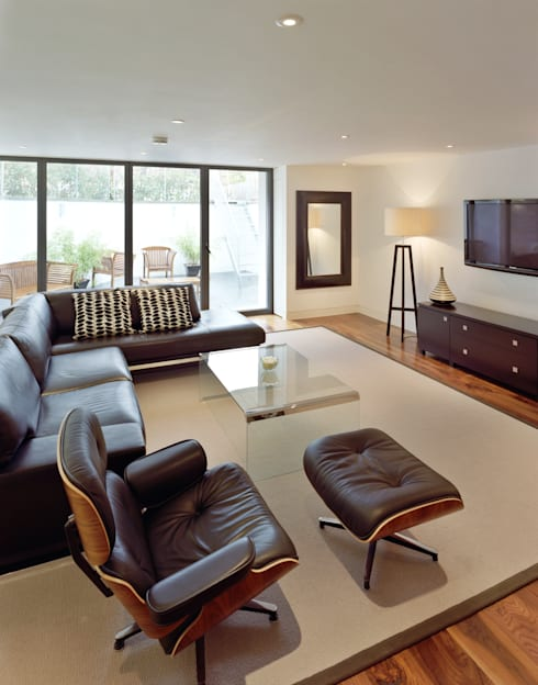 Natropolis Apartments: modern Living room by Coupdeville